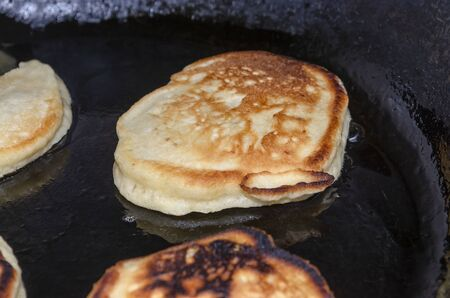 Toasted pancakes are fried in a black pan