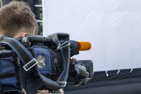 Cameraman makes movie news white background