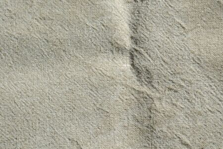 Background, texture of natural crumpled linen fabric