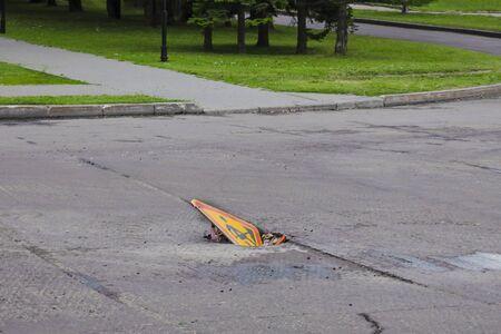Road repair in the city road sign caution road repair, cut asphalt pavement
