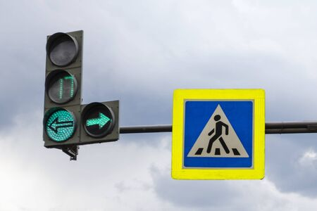 Road sign caution pedestrian crossing and traffic light with stopwatch and green signal Stock fotó