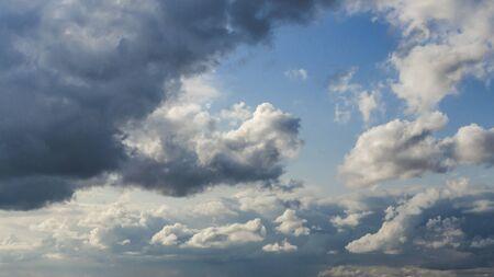 Beautiful curly cumulus clouds in the blue sky