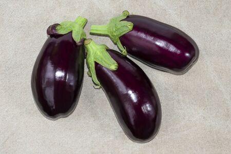 Harvest eggplant. Ripe purple eggplant close-up on a linen tablecloth