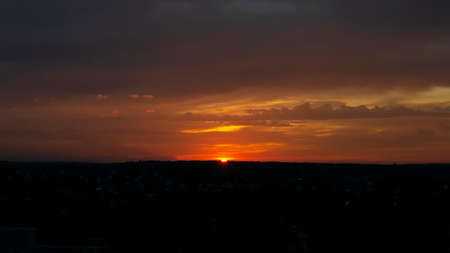 Bright colorful sunset. Dark sky with orange reflections