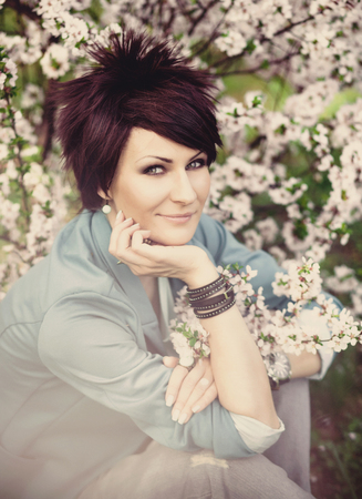 Cherry blossom season female material of beautiful women in blue jacket