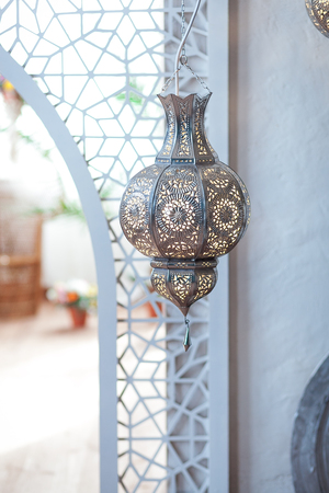 Selective focus point on Morocco light lantern decoration in living room interior - Vintage Light Filter Stock Photo