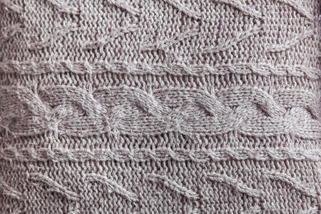 cable knit: Beautiful gray knitted pattern, knitted scarf close up. Knitted background Stock Photo