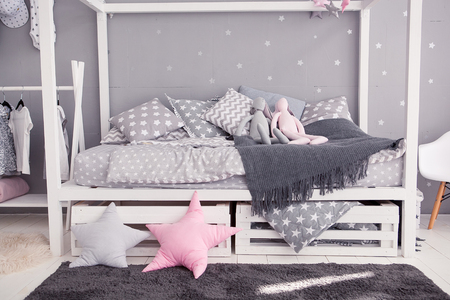babyroom: Cozy childrens bedroom in scandinavian style with diy accessories Stock Photo