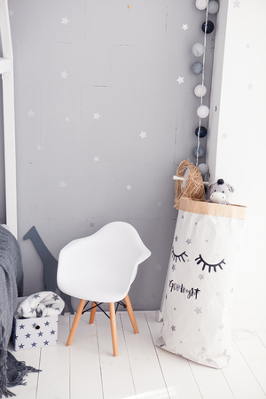 babyroom: Toddler room with white cradle, chair and storage bag