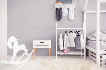 babyroom: Empty nursery room with clear wall, toys and wooden horse Stock Photo