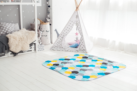 Modern interior of the childs bedroom with carpet in front