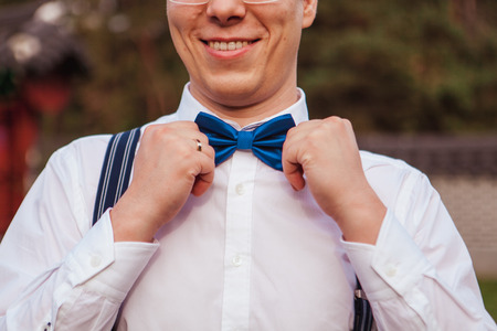 Elegant gentleman clother. shirt and blue bow tie