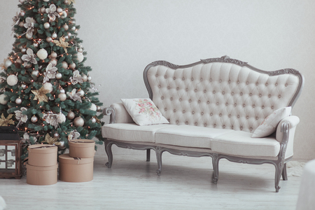 Christmas and New Year Eve Tree. Holiday winter background. Interior details - sofa, vintage gifts, candles. Isolated wall