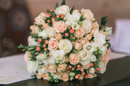 Wedding bouquet of small white and pastel pink roses and berries stock photo wedding bouquet of small white and pastel pink roses and berries mightylinksfo