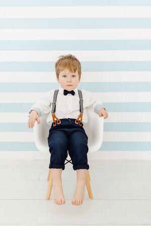 Caucasian Little Boy Sitting Straight on Chair