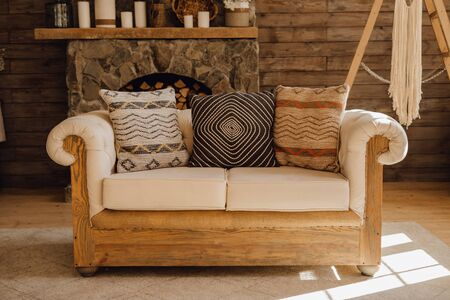 Wooden Sofa in Chalet Cozy Interior with Fireplace