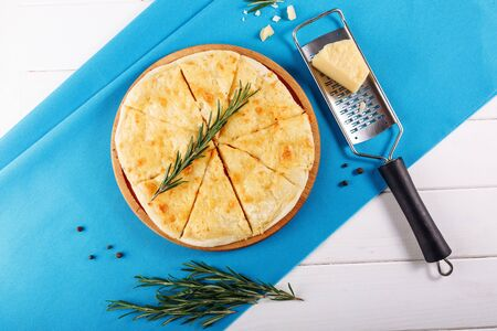 Four Cheese Pizza Top Flat Lay on Blue Background