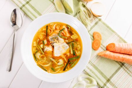 Fish Seafood Yellow Soup with Vegetable Flat Lay
