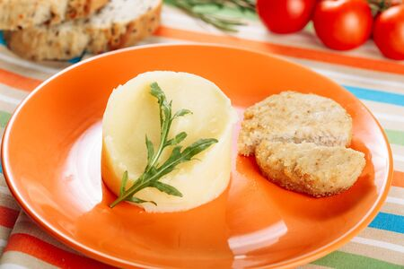Mashed Potato Chicken Cutlet in Orange Plate
