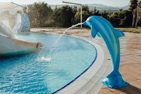 Fountain in Form of Dolphin near Swimming Pool