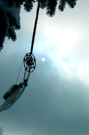 moutains: dreamcatcher, sun in cloudy sky