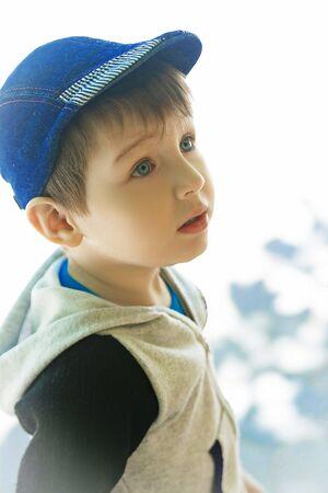 ��beautiful boy�: blue-eyed beautiful boy in a denim cap