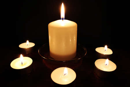 The composition of the candle lights on the black background Stock Photo