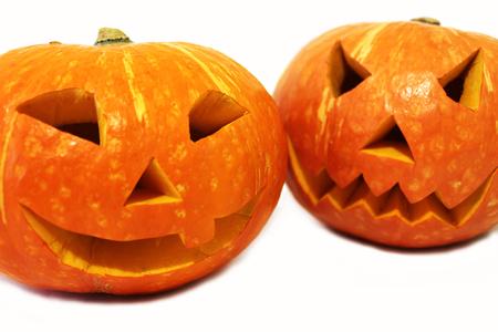 Two halloween pumpkins (Jack-o'-lantern) isolated on white background 免版税图像