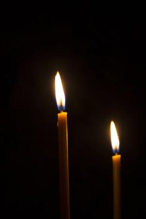 Church candles burning in the dark