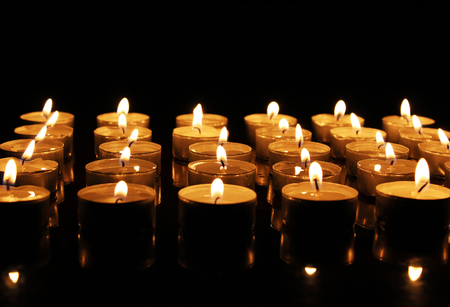 Many burning candles with copy space area