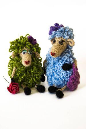 Handmade knitted toys (glamorous sheep) isolated on white background
