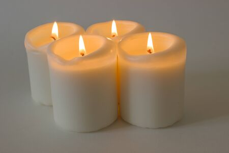 Set of white burning candles