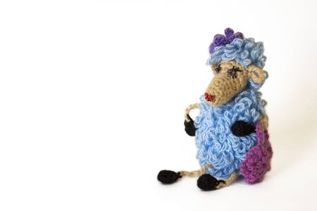 Handmade knitted toy (glamorous blue sheep) isolated on white background. With copy space area 免版税图像