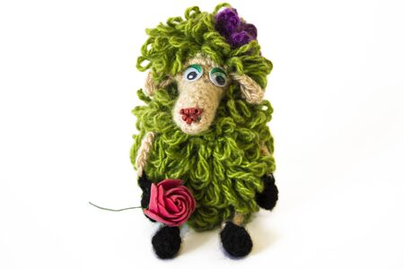 Handmade knitted toy (glamorous green sheep) isolated on white background 免版税图像