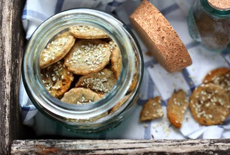 sesame cracker: rye crackers with sesame seeds and cumin in a glass jar Stock Photo