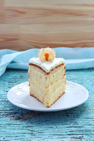 winter cherry: piece of homemade cake decorated with winter cherry on a blue background