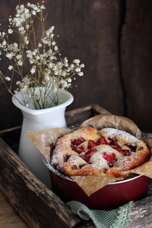 homemade strawberry tart in a baking dish, shot with natural light Stock Photo