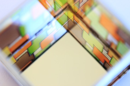 window shades: The image of a multicolored stained glass window with irregular block pattern in shades of green, orange and brown
