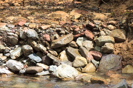 murmur: water of the mountain river and a large stone