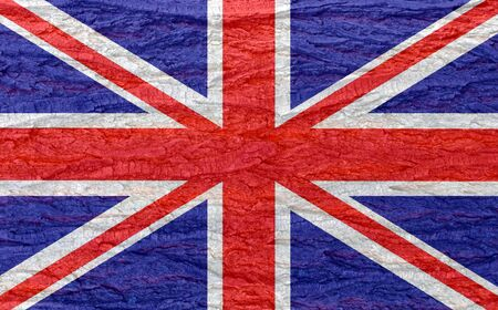UK flag on bark texture background. Background for greeting cards for UK public holidays. Day of Remembrance and Reconciliation. May holiday. Spring day off. Queen's birthday.