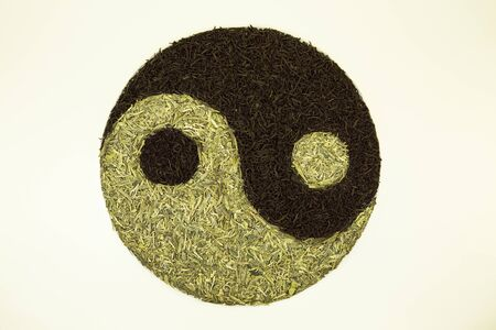 Sign Yin Yang with tea. Used Chinese black tea and green Lundzin. Healthy eating concept.