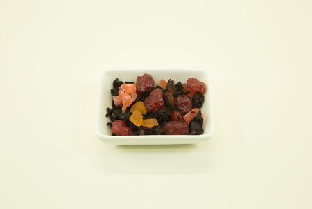 Chinese tea. Chinese fruit tea with hibiscus. The fruit tea with hibiscus isolated in a white bowl on a white background
