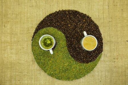 The concept of yin yang. Sign yin yang against the background of burlap. Japanese match tea with fried rice and Cuban coffee were used.