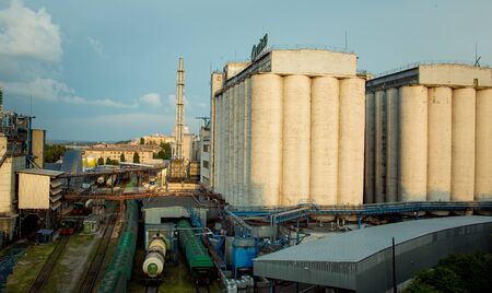 Grain elevators for storing oilseeds and grains. A view of the infrastructure of the elevator at oilseed processing plant.