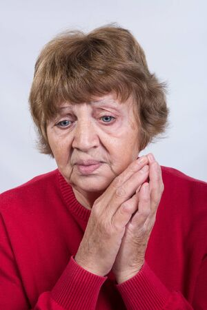 Portrait of an aged woman. The concept of emotions. Very expressive blue eyes.