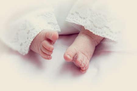 Children Babies. Child care. Small legs of a newborn baby.