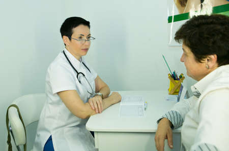 A visit to a beautician. The doctor tells the patient about the need for facial skin care.