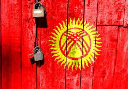 Flag of Kyrgyzstan is on texture. Template. Coronavirus pandemic. Countries may be closed. Locks.