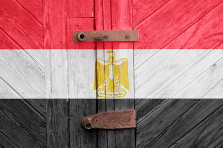 Egypt flag is on texture. Template. Coronavirus pandemic. Countries may be closed. Locks.