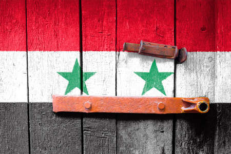 Syria flag is on texture. Template. Coronavirus pandemic. Countries may be closed. Locks. Foto de archivo